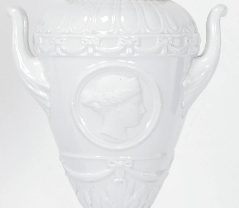 Mid-20th Century Pair of White Porcelain Urn Table Lamps with Male and Female Busts in Relief For Sale