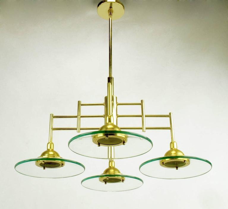 North American Architectural Four-Light Brass and Glass Pendant Halogen Chandelier For Sale