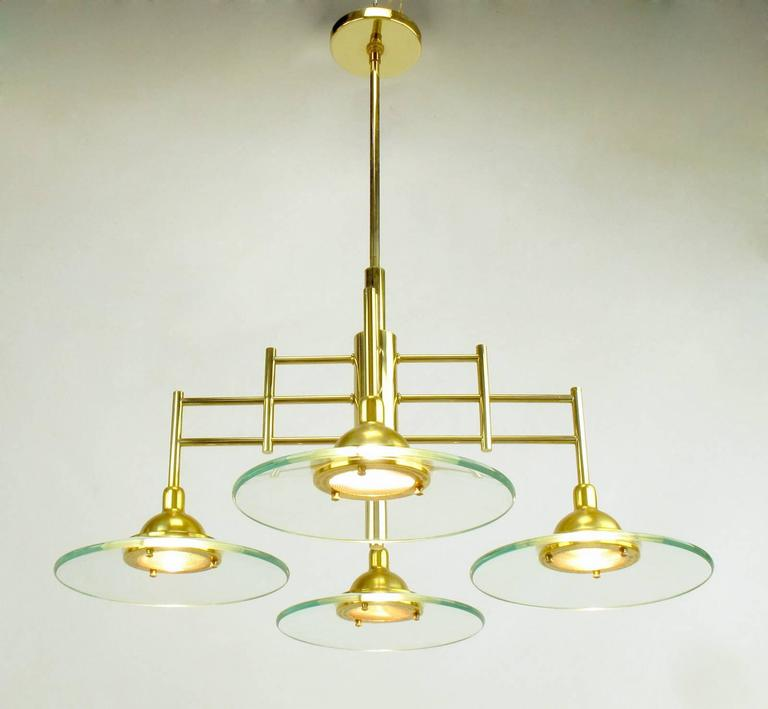 Architectural Four-Light Brass and Glass Pendant Halogen Chandelier In Good Condition For Sale In Chicago, IL