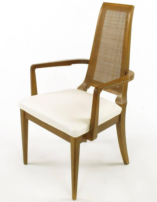 Sleek, circa 1950s Modern Walnut and Cane Dining Chairs In Excellent Condition For Sale In Chicago, IL