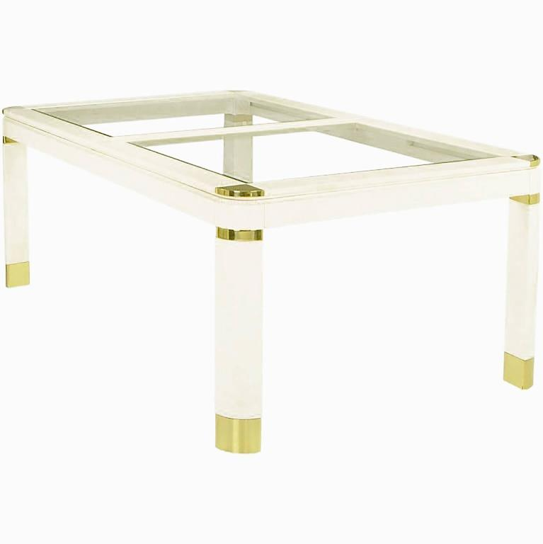 Superb dining table in ivory lacquer over wood, with two one-half inch thick beveled glass inserts. Accented by brass sabots, banding, and corners. With two solid wood ivory lacquered 20