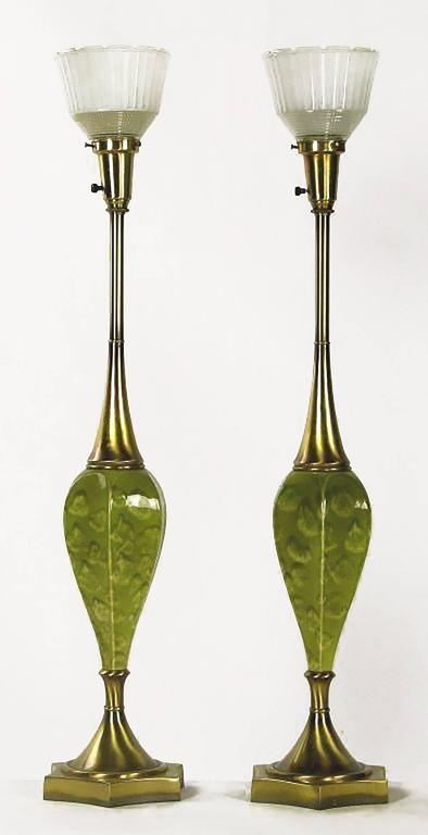 Colorful green lamps, with a green oyster pattern glaze over inverted bulblike ceramic bodies. Base and top are antiqued brass, with the trademark Rembrandt Holophane style glass diffusers. Sold sans shades.