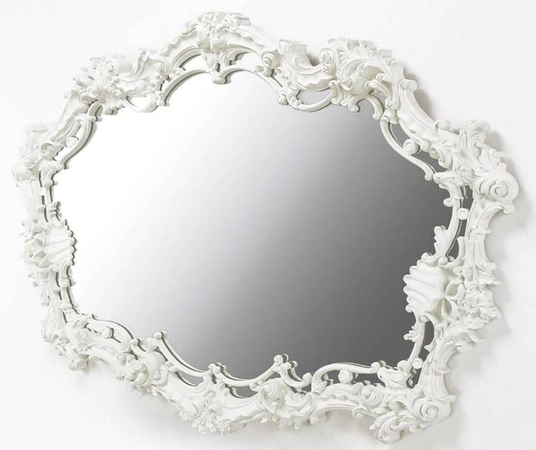 Extraordinary cast gesso Italian Rococo style mirror in white lacquer with filigree and shell detail. Perfect for a vanity, over mantel or in the bedroom over a long dresser. Serge Roche and Dorothy Draper were both proponents of monochrome white