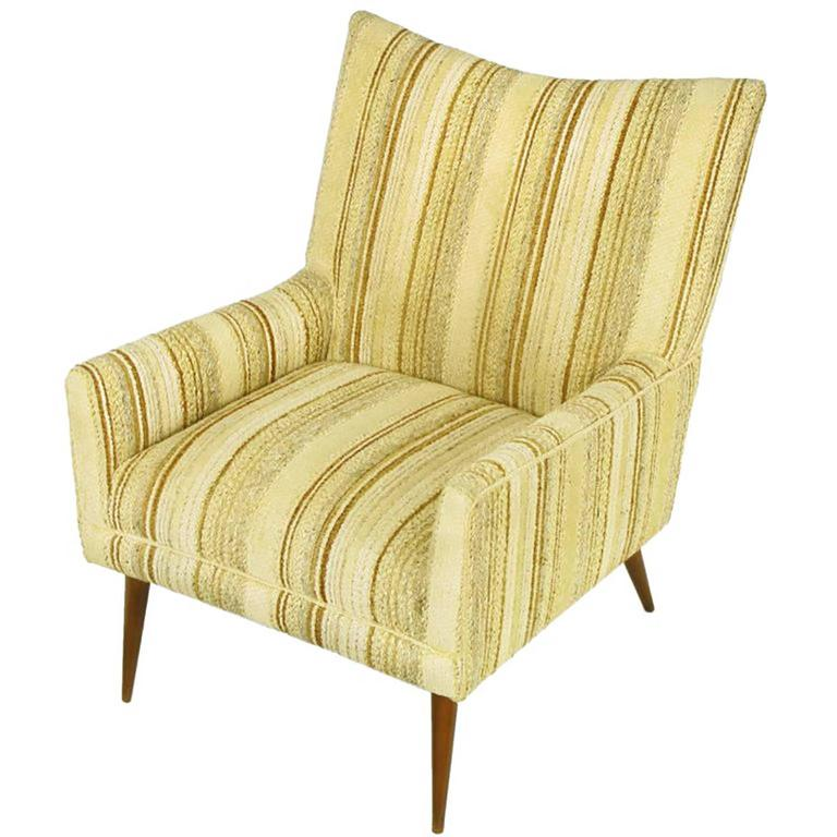Original Paul McCobb lounge chair in umber, gray and taupe striped loose weave wool upholstery and long tapered maple legs. Great front view as well as profile with M-shaped back and raked back legs.