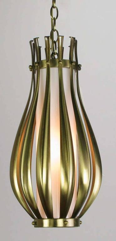 Ribbed and brushed brass gourd form pendant hanging light fixture, with a milk glass internal shade. Detailed with brushed brass balls. Similar to some designs by Gerald Thurston for Lightolier. Single socket incandescent lighting element. Comes