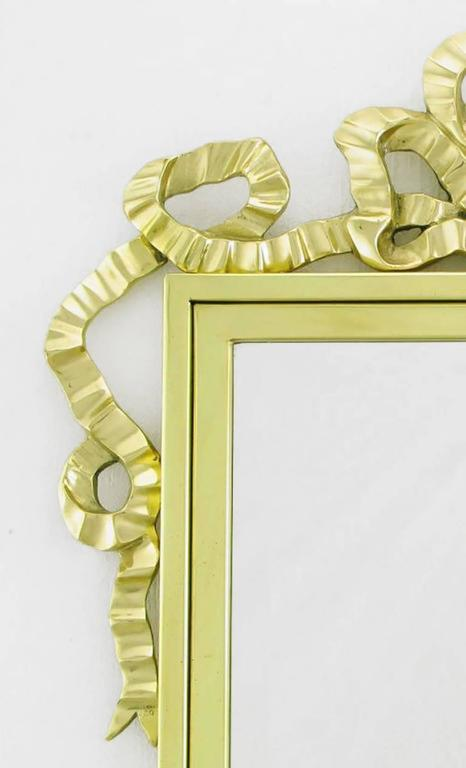 Brass wall mirror with solid brass ribbon swag for sale at for Decorative crafts inc brass
