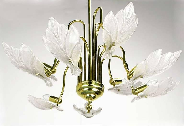 Elegant nine-arm Murano glass leaf shade chandelier in the style of Barovier & Toso. Each leaf is opaque bubble glass with gold leaf inclusions. 360 possible watts of illumination. Matching sconces available. Believed to be of Italian origin.