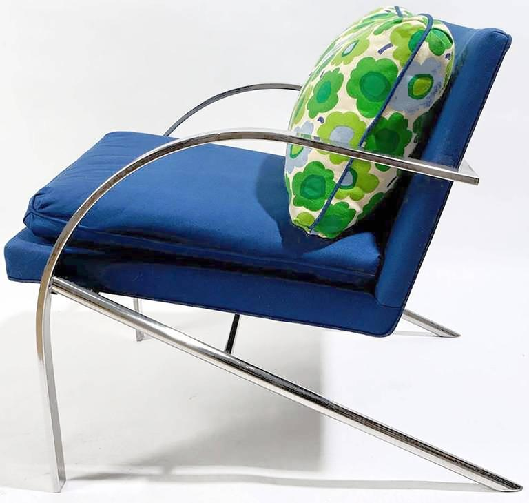 """Excellent pair of """"Arco"""" chairs in the style of Paul Tuttle. Upholstered in a vintage royal blue wool blend, with back pillows of brightly colored Marimekko style floral fabric of white, blues, and greens."""