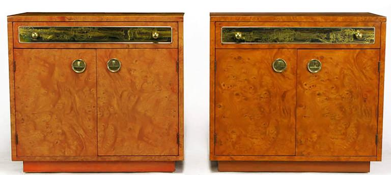 Mastercraft nightstands in beautiful burl amboyna wood veneer. Toned in a tangerine lacquer, a rare offering from Mastercraft, with Bernhard Rhone acid etched panels. Top drawer and lower cabinet space make them functional as well. Brass inverted