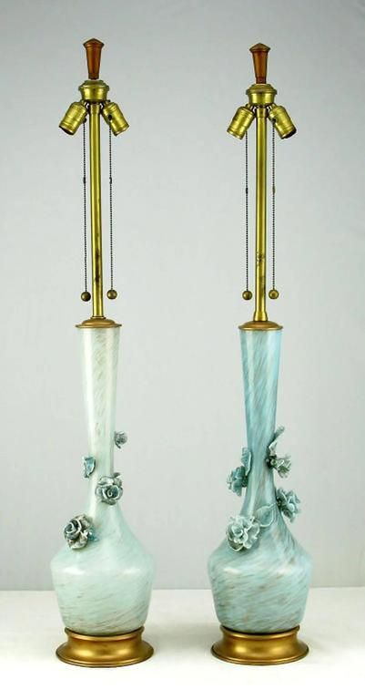 Pair of large blue handblown Marbro table lamps. Blue Murano handblown glass bodies have internal flecks of gold. Gold leafed brass caps and bases. Each lamp adorned with blue glass flowers and leaves. handblown glass can have some color variation