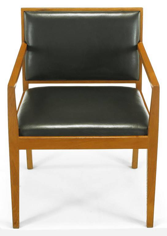 Set of four ashwood and dark chocolate leather armchairs by Interior Crafts of Chicago, custom furniture maker to the trade. Possibly a Bert England design who, along with Richard Himmell among others, designed for Interior Crafts in the 1960s.