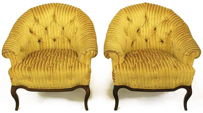 Pair of button tufted, cut and striped gold velvet lounge chairs with rolled sloping arms and barrel back by Interior Crafts, Chicago custom furniture manufacturer to the trade. Carved walnut cabriole legs with scalloped walnut apron. Among others,
