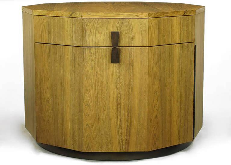 Seldom seen Harvey Probber bleached rosewood decagonal bar cabinet with single drawer and piano hinged door with integral shelving. Door and drawer are accessed via a split hour glass shaped rosewood pull. Mounted on a round dark walnut base. Open