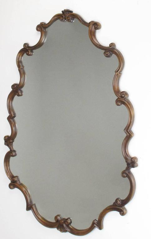 Large French Regency style fruitwood framed mirror. Excellent workmanship with a wood backing and expertly carved scrolled fruitwood frame. Measure: 53