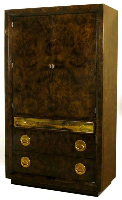 Mastercraft burl amboyna wood tall wardrobe cabinet. Three drawers in the base with top drawer faced with an acid etched panel by Bernhard Rohne. The upper compartment is fronted by two doors, and offers storage in three drawers with a shelf above.