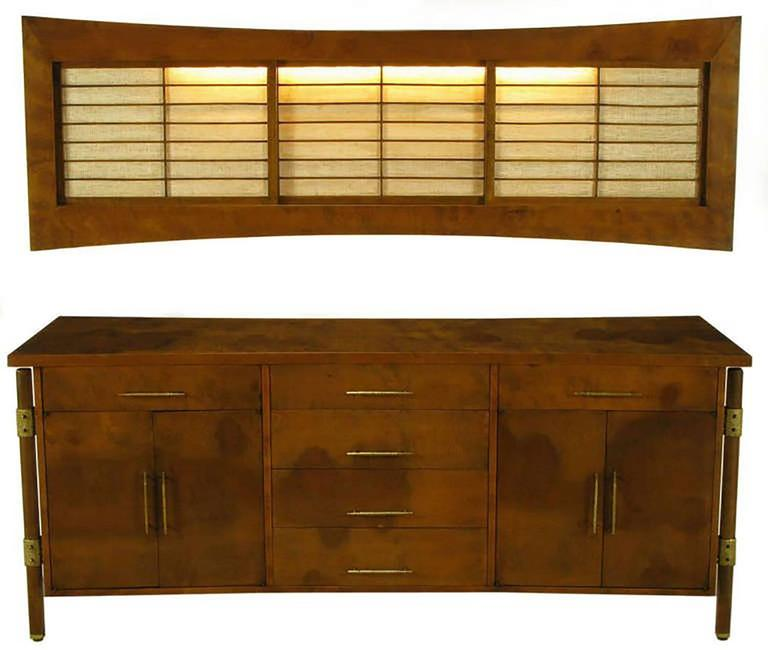 Designed by Harold M. Schwartz for Romweber. Burled walnut side board with fiddle back highlights. Brutalist textured brass hardware, including brackets connecting the outboard legs to the case. Sideboard features long pulls on the six drawers and