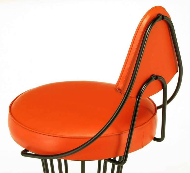 Faux Leather Set of Four Sculptural Black Wrought Iron and Persimmon Bar Stools For Sale