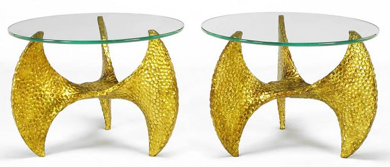 Pair of cast and dimpled resin propeller end tables with an antiqued gilt finish. A petite and more interesting version of the aluminum propeller tables created by Knut Hesterburg. Custom-made in Chicago by the defunct Chicago Statuary Company. 20