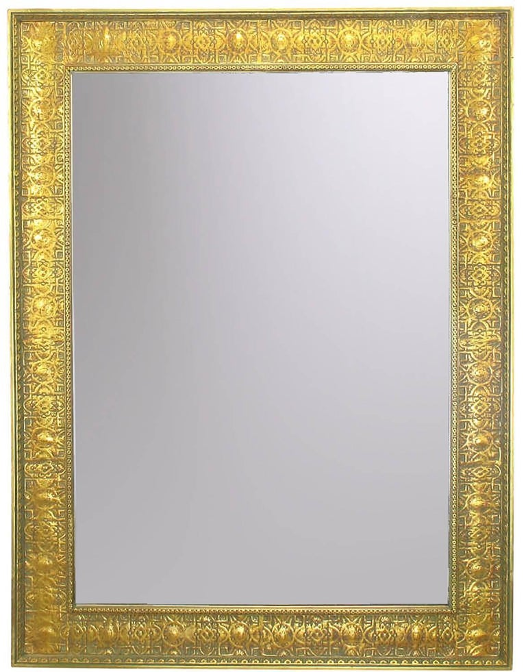 Pair of large gesso and wood framed wall mirrors with Egyptian motif. No doubt inspired by Howard Carter's 1922 discovery of King Tut's tomb. One mirror shows more bole through the gold leaf than does the other. Minor repairs and touch ups to both