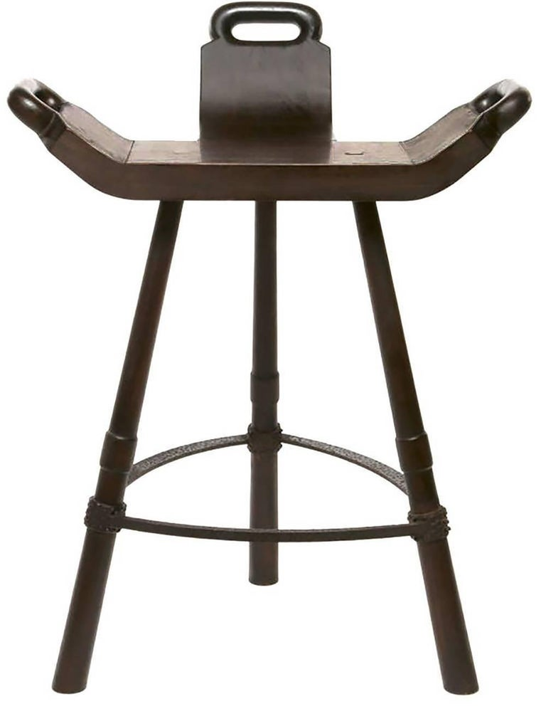 Pair of tripod-base bar stools with seats inspired by Primitive birthing chairs. Hand-hammered iron stretchers with Brutalist texture, and walnut wood legs and seats. Seats have integral back support and hand grips.
