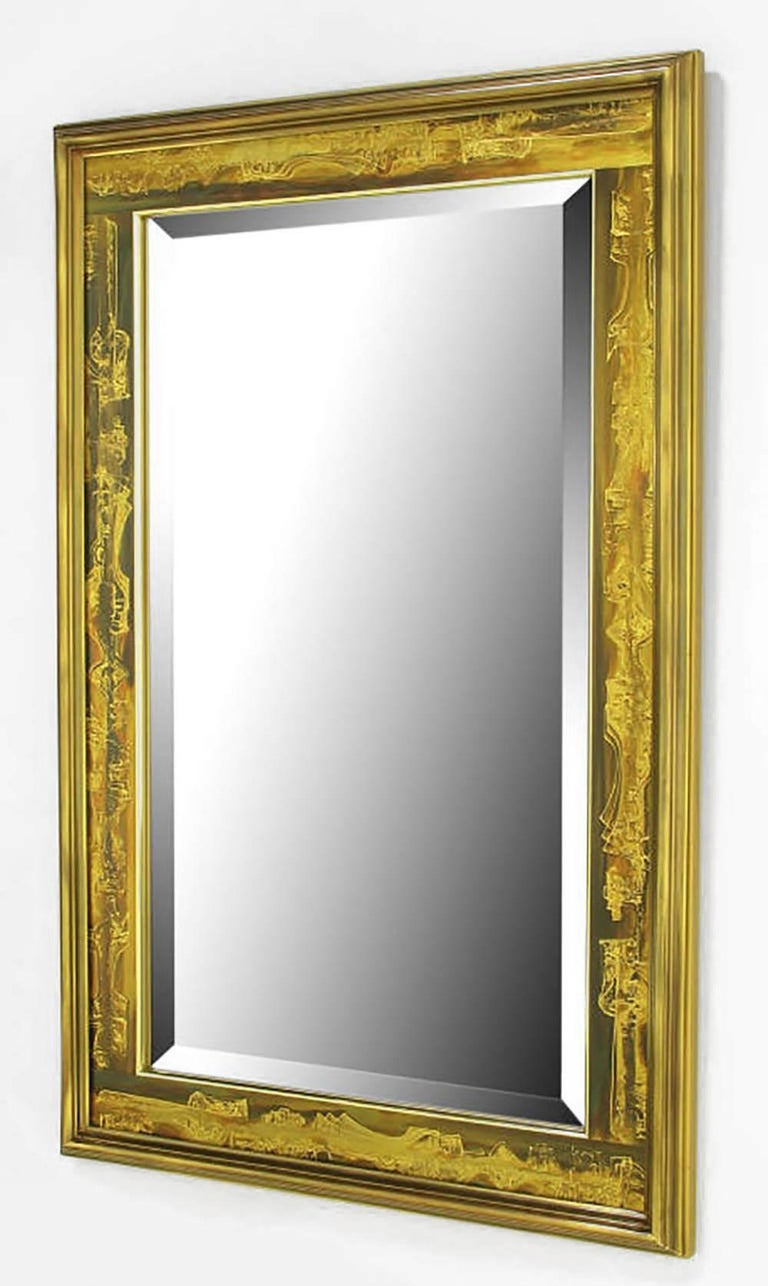 Bevelled mirror with a Mastercraft, Bernhard Rohne designed acid etched panel and bevelled solid brass frame. Backed by a gold lacquered wood panel.
