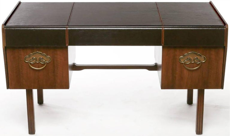 From California designer Bert England's Orientation Group for John Widdicomb Company, this extraordinary desk is made of Persian walnut and solid mahogany.   Wrapping around the front and back, including upper drawer fronts, the black leather top