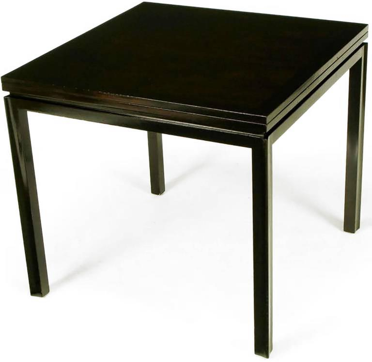 Edward Wormley for Dunbar #2299 ebonized walnut flip-top game table, with ebonized mahogany skirt and reverse quatrefoil legs. Top rotates and flips to convert to a dining size tabletop of 64