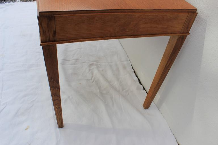 """Unique patinated oak desk and chair with double X-back by Jacques Adnet  Measures: Desk 43.63"""" W x 26.25"""" D x 29.25"""" H  Chair 18.5"""" W x 19"""" D x 35"""" H seat height 19"""""""
