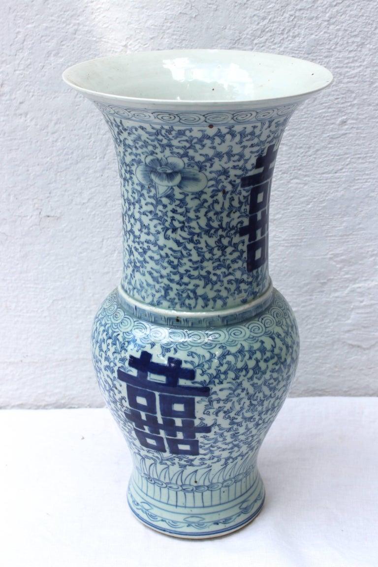 Chinese blue and white trumpet shape vase.