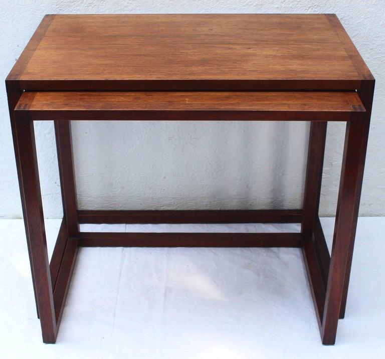 Set of two Swedish teak nesting tables by Karl Erik Ekselius for JOC Möbler.  Measures: Smaller table: 23.25