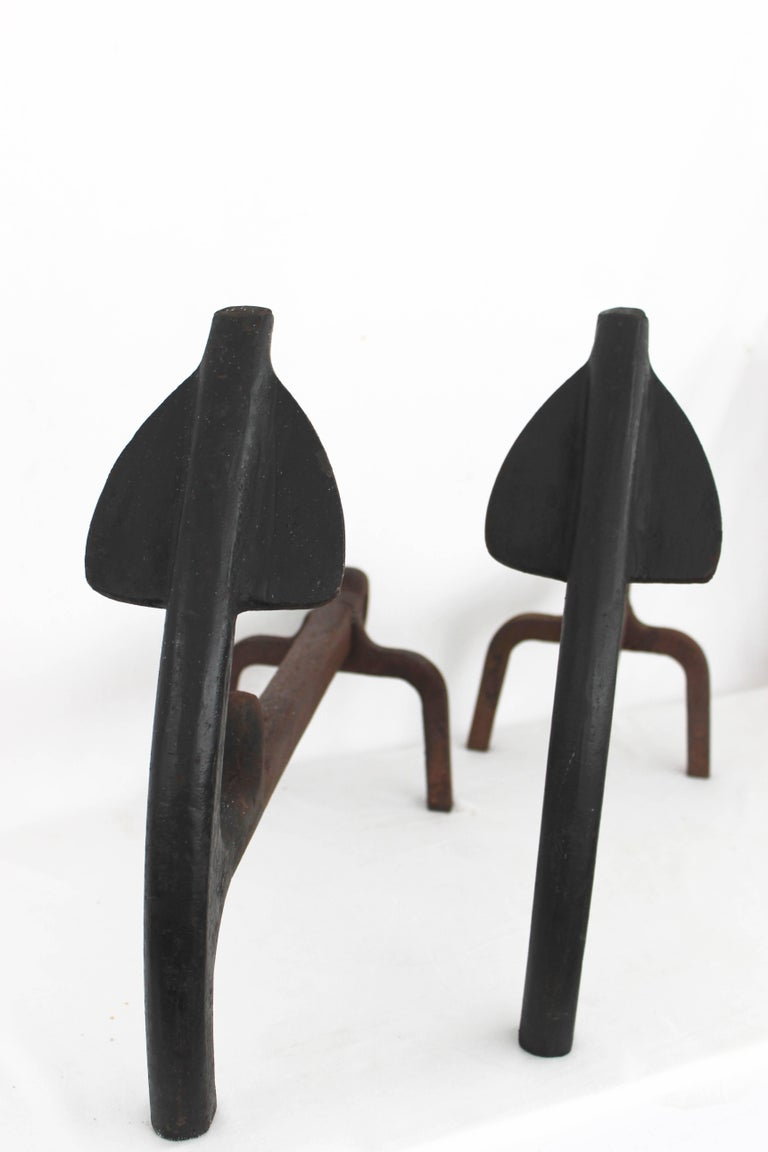 Pair of wrought iron anchor andirons/ log holders.