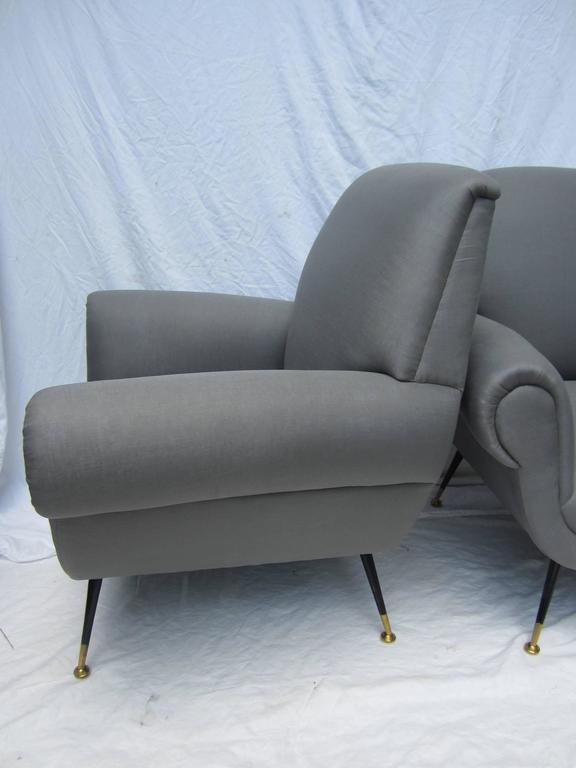 Pair of Italian arm chairs by Gigi Radice for Minotti newly upholstered in gray linen.....steel and brass legs.