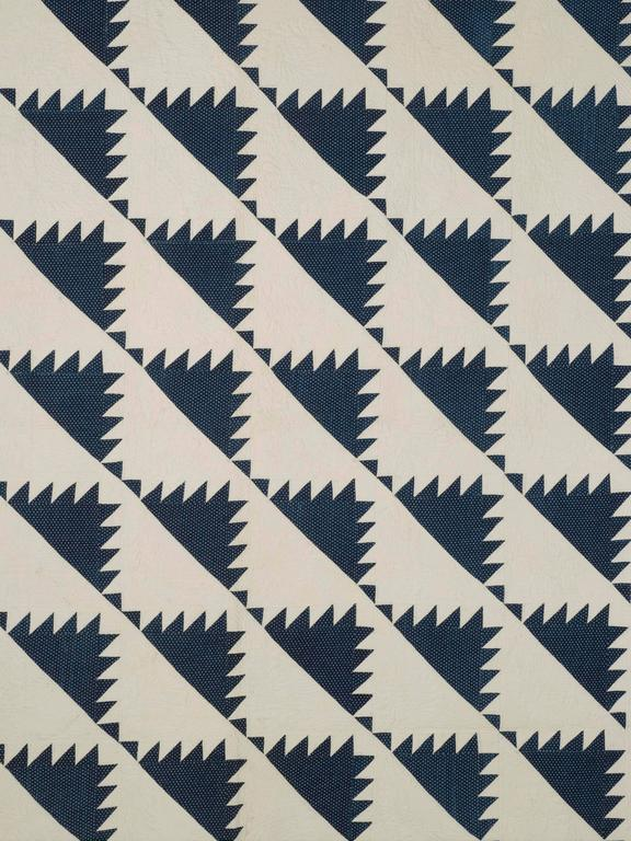 "Antique quilt: ""Delectable Mountains"" or ""sawtooth"" variation, third quarter of the 19th century, New England origin. Blue and white quilts have always been among the favorites of collectors; here is an exceptional example of fine quilt stitchery at"