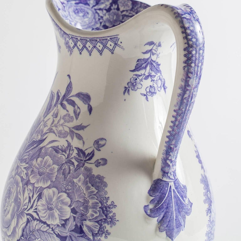 "This pitcher with voluptuous bouquets of lavender blossoms is marked; ""Jardiniere"" Sarreguimines, France.