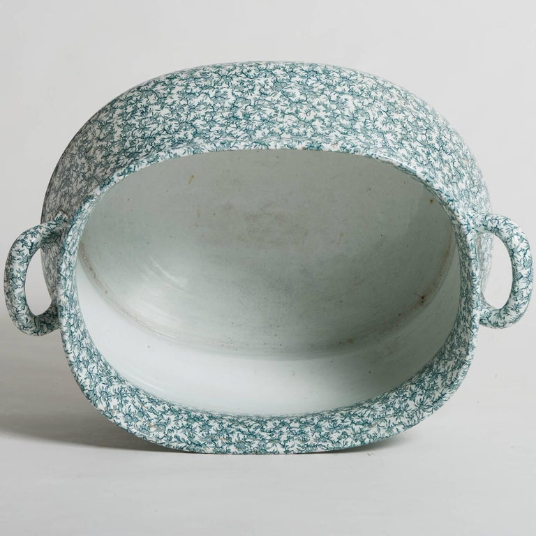 This Ironstone footub with a curved oval shape and two handles has a charming pattern of green flowers against a white background. It has the important mark of Creil and Montereau, Fine maker of porcelain and pottery in the 19th century.