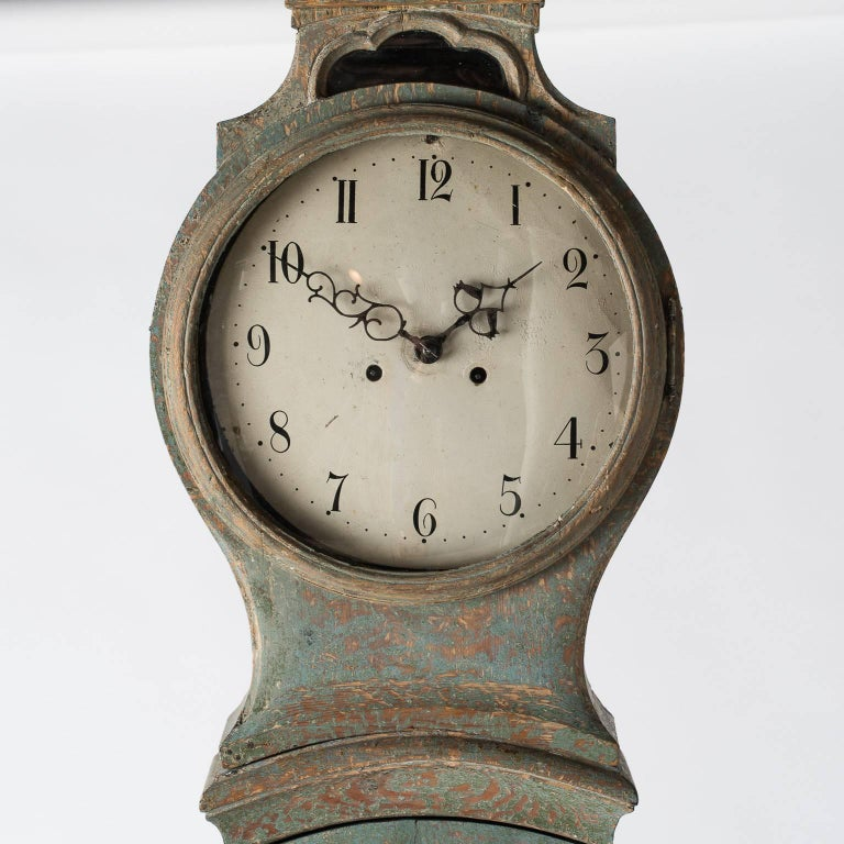 This Mora clock has many beautiful details making it an excellent example of the period. The bonnet features windows on the sides that allow one to see the clock works. The blue original paint surface is in lovely condition.