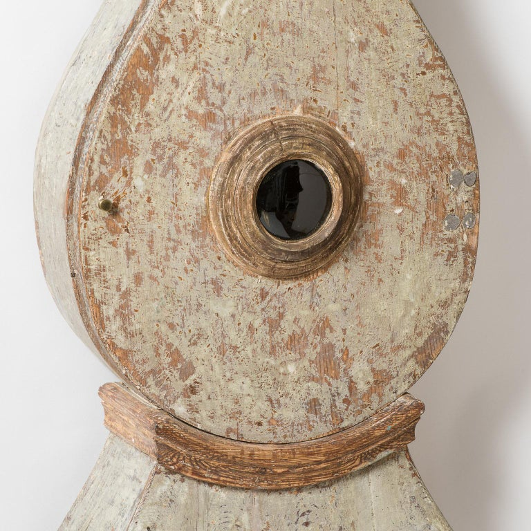 This special Mora clock has an elegant proportion with a slightly exaggerated wide middle curving into a graceful narrow neck. The crown with the cross, surrounded by oak leaves, indicates that it was likely made for someone in the royal household