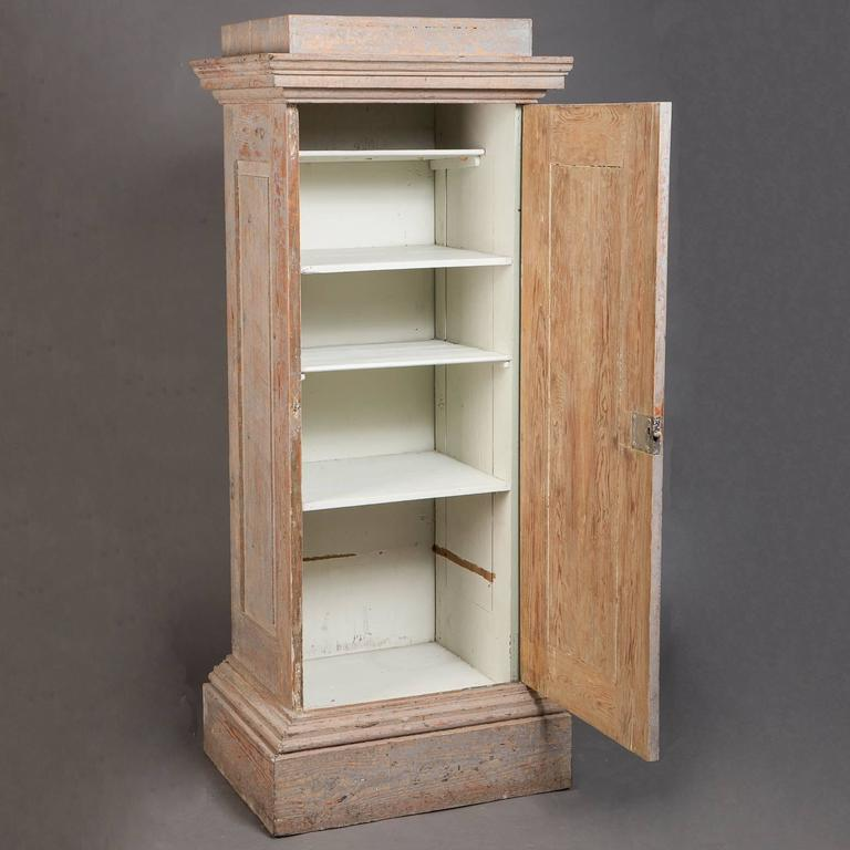 Another great contribution of Swedish design, this cupboard looks like an elegant column but it is extremely useful for storage. With the door opened it works as a display piece, and closed for storage of linens or dishes in a dining room. The pale