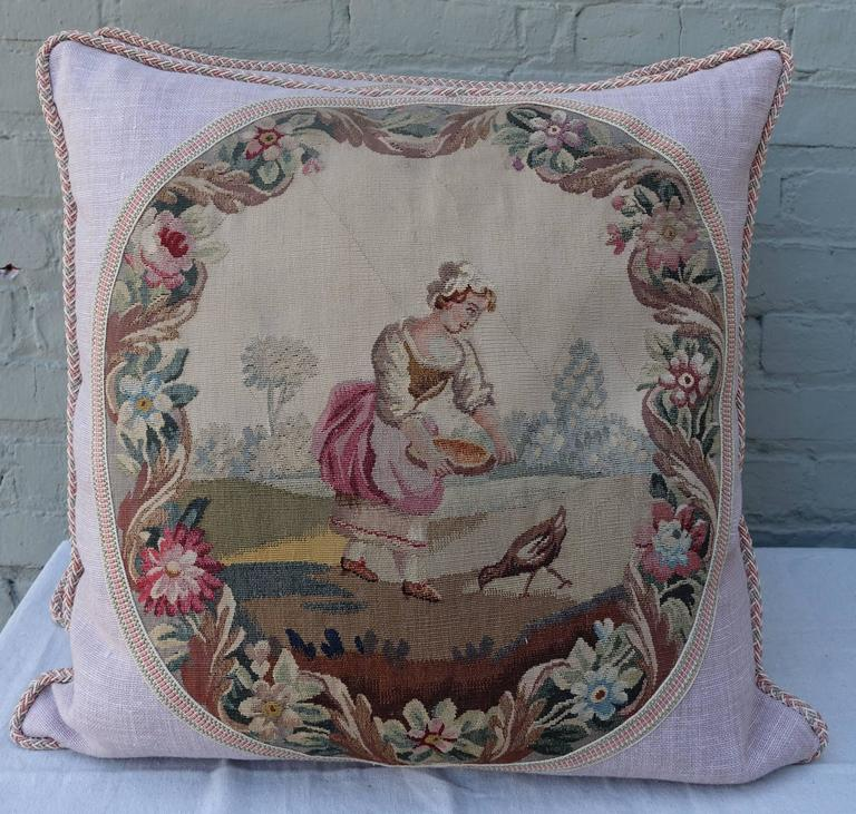 Pair of charming custom pillows made with 19th century Aubusson textiles combined with contemporary linens and trims. Down filled inserts.