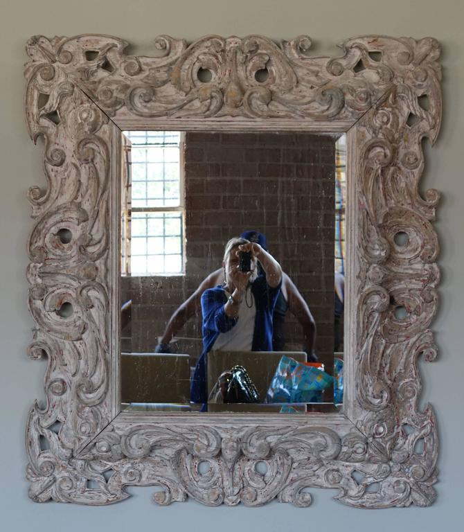 Antique Italian carved painted mirror with bevel.