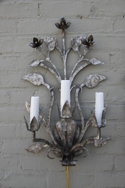 Pair of three-light antiqued silvered sconces that have been newly rewired and are ready to install. Cream colored drip wax candle covers.