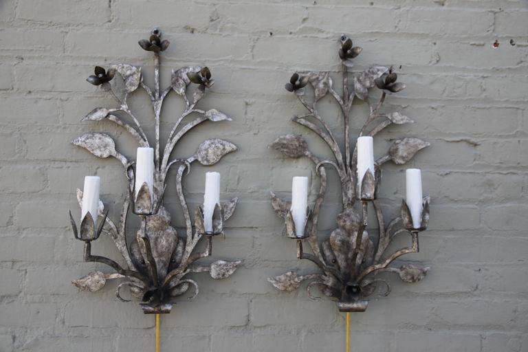 Metal Pair of Three-Light Silvered Sconces For Sale