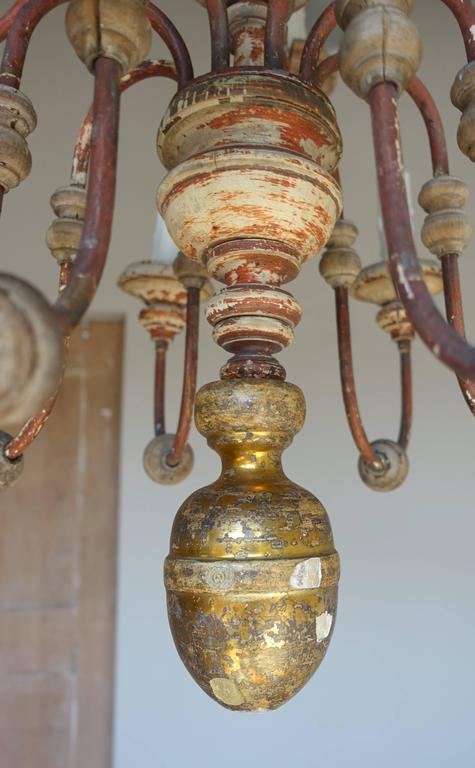 Twelve-Light Italian Wood and Iron Painted Chandelier In Distressed Condition For Sale In Los Angeles, CA