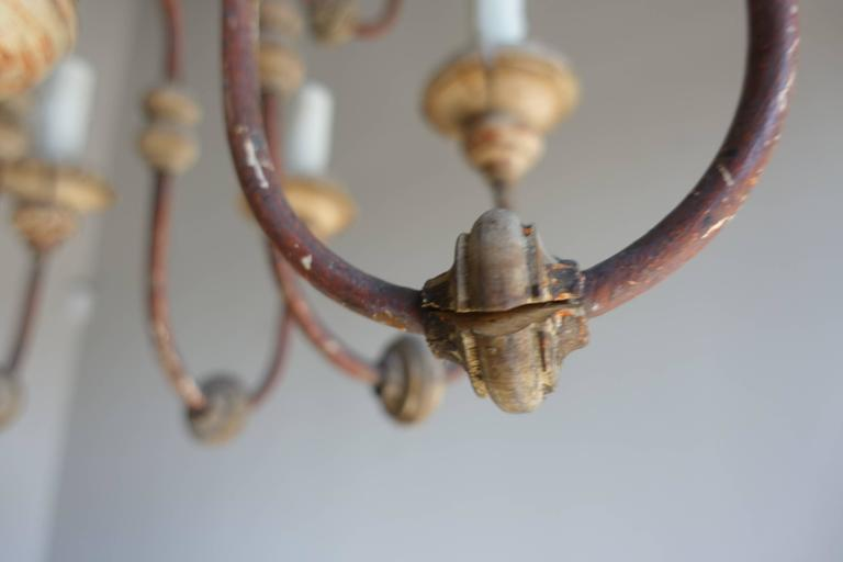 Early 20th Century Twelve-Light Italian Wood and Iron Painted Chandelier For Sale
