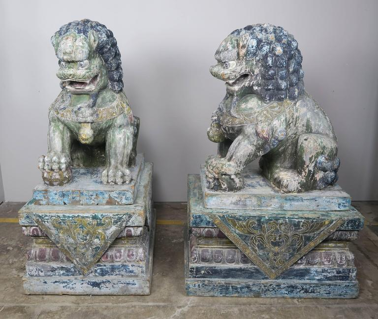 Pair of Monumental Carved Wood Painted Foo Dogs 1