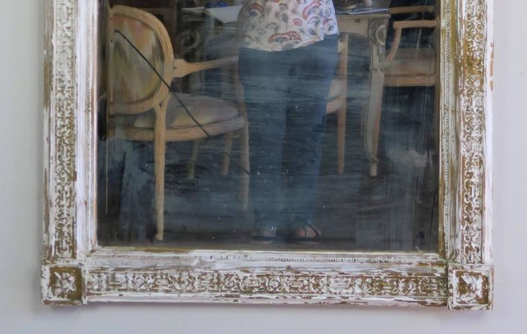 Italian painted and gold leaf neoclassical style mirror with pair of reclining cherubs. Mirror has 1