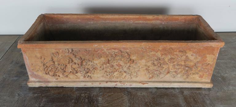 Italian terra cotta rectangular shaped planter box with beautiful reliefs throughout.