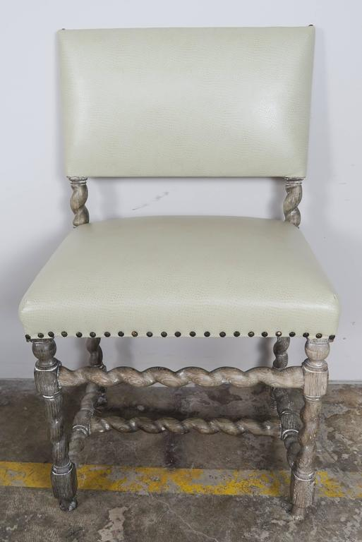 Ten spanish dining chairs with faux ostrich upholstery at