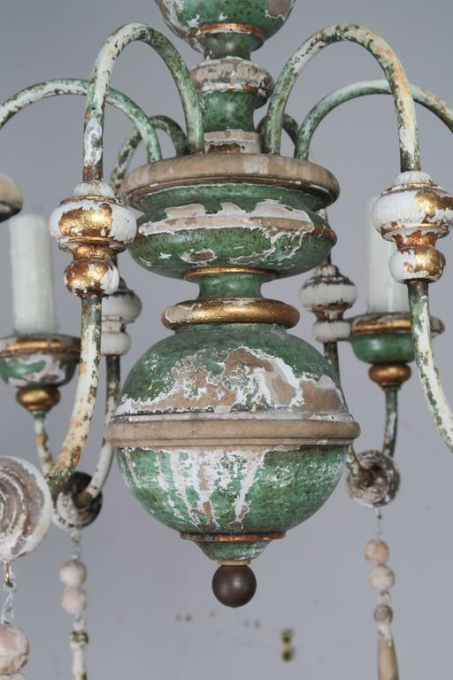 Italian Painted and Parcel-Gilt Chandelier with Wood Drops In Distressed Condition For Sale In Los Angeles, CA
