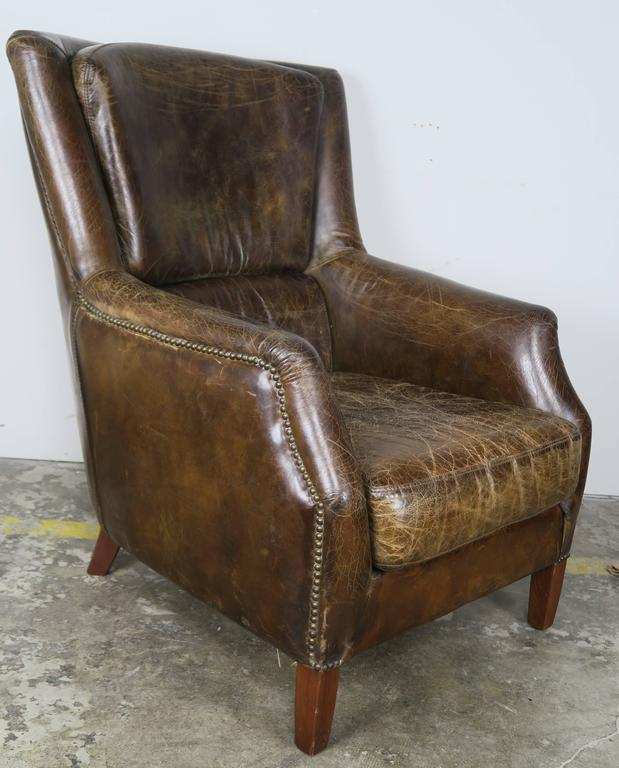 Pair of Tobacco Colored Leather Armchairs In Distressed Condition For Sale In Los Angeles, CA